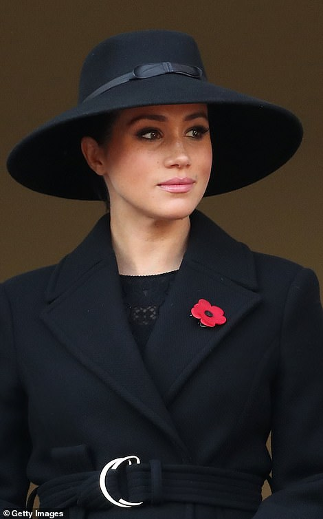 The Duchess of Sussex was pictured looking somber at the Cenotaph as she remembered those who have given their lives in conflict for the British armed forces