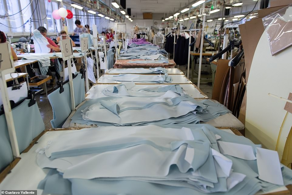 The cramped, stuffy, oblong room on the second floor 'stitching room' at the factory buzzes with activity as workers attempt to complete light jackets and blazers from the designer's latest range (pictured) and meet their daily target
