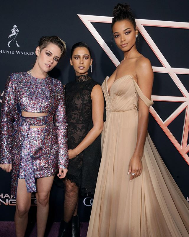"""Kristen Stewart, Naomi Scott, and Ella Balinska the stars of the new """"Charlie's Angels"""" at the film's premiere in L.A.   Recently, WWD chatted with @ellabalinska about her character and she gave us an inside look at the film.   For Balinska, in particular, it was an opportunity to put to work her two great loves: sports and acting. Sitting in her hotel room a few months before the movie's release, the actress lights up when discussing how her sports background comes into play in the movies she's working on.  """"This is a really exciting topic for me,"""" she says, folding her long legs in a pretzel and showing a toothy grin. """"When you do a lot of sport, you gain physical awareness, you know your strengths, you know your limits, you know how to push yourself in certain ways — even mental awareness. It's a discipline. You wake up and you train.""""   In regards to costars Stewart and Scott, Balinska said they got along as soon as they met, adding it's """"a sisterhood onscreen and offscreen.""""  Tap the link in bio for more.   Report: @maxinesleep  📸: @shutterstocknow . . . . . #wwdeye #charliesangels  #ellabalinska  #kristenstewart  #naomiscott"""