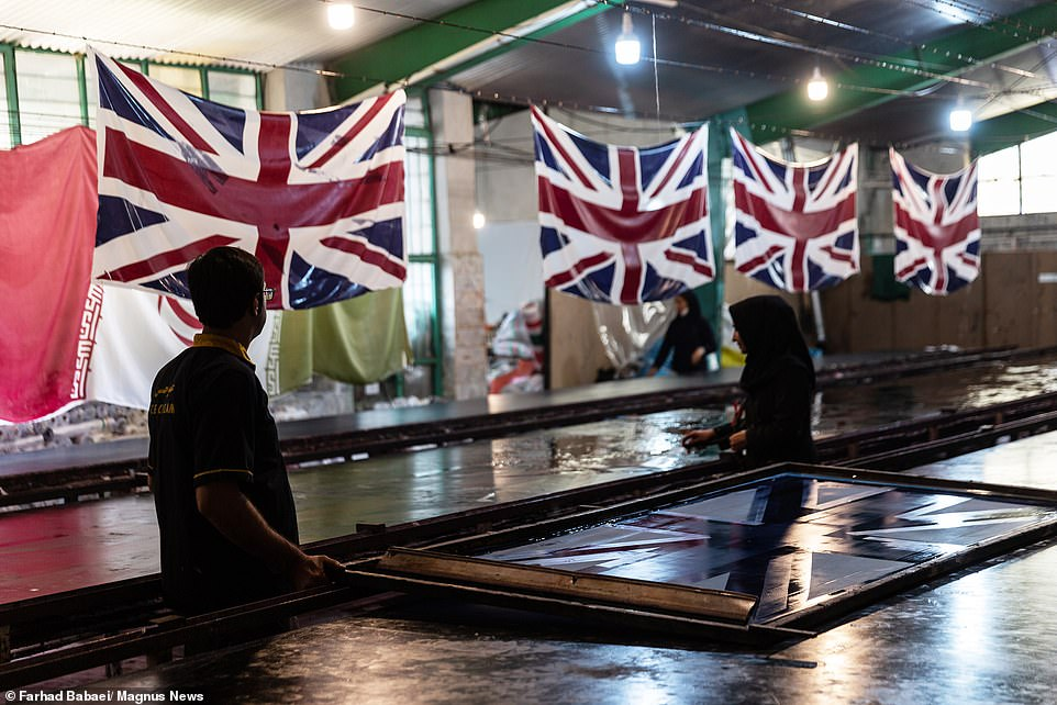 The factory is in Khomeini City, about four hours south of Tehran. As well as British and US flags, the manufacturer produces Israeli flags