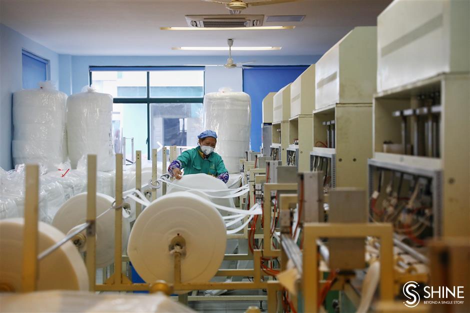 Shanghai mask factory scrambles to meet demand