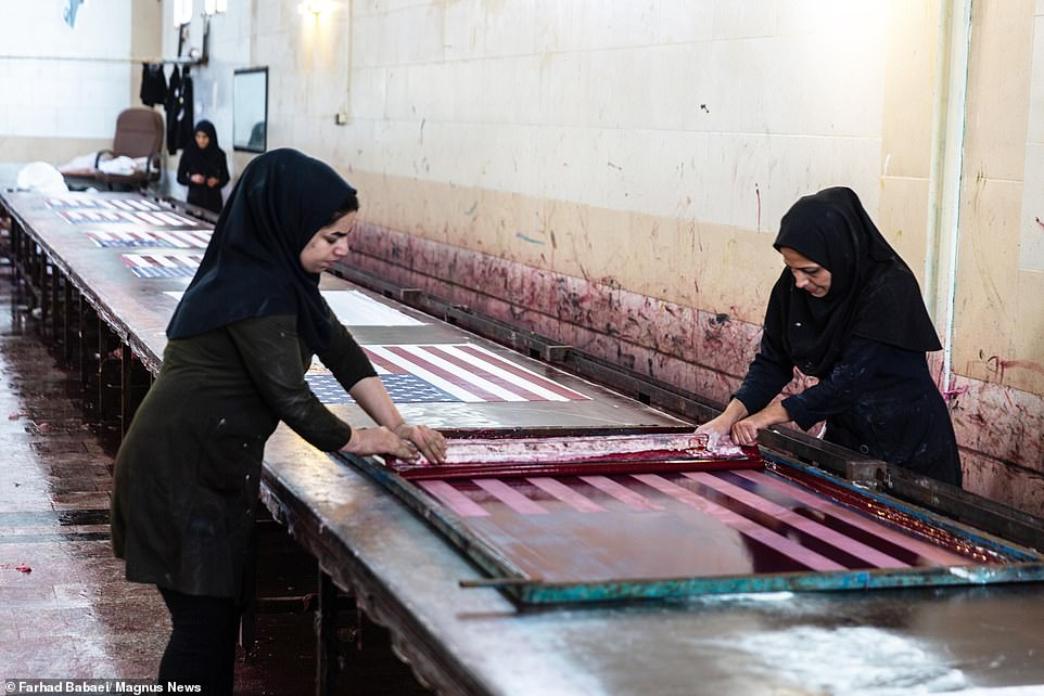 Each flag is painstakingly printed on the stone with templates by hand before being hung to dry and later washed