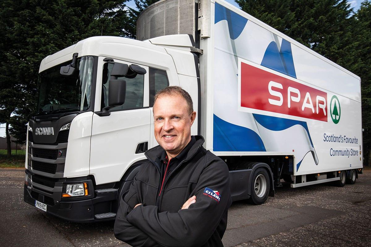 Man In Front Of Spar truck