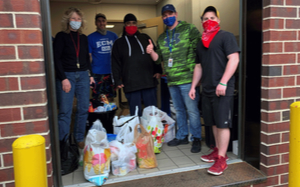 Logistics Plus employees with surgical masks