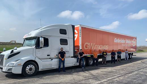 Gebrüder Weiss and Delta Group Logistics employees in front of truck