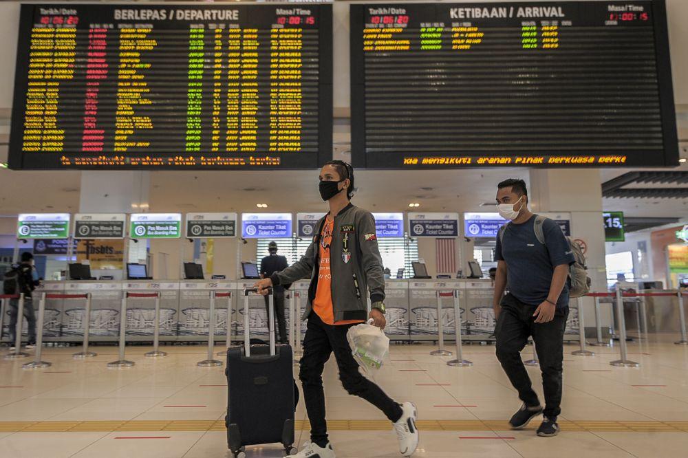 People wearing face masks are pictured at Terminal Bersepadu Selatan in Kuala Lumpur June 10, 2020. — Picture by Shafwan Zaidon