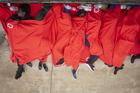 Migrants rest at the port of Tarifa, southern Spain, on July 27 after being rescued by Spain's Maritime Rescue Service. Authorities said751 migrants were rescued from52 dinghies trying to reach Spanish shores from northern Africa, this year's most popular route into Europe for human traffickers. (AP Photo/Marcos Moreno)