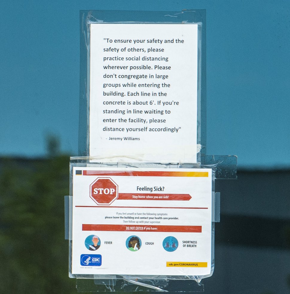 (Rick Egan | The Salt Lake Tribune) Sign on the door of Sportsman's Warehouse distribution center in west Salt Lake City, Monday, Aug. 10, 2020.
