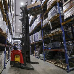 Zach Costigan, Associated Foods senior inventory control specialist, moves a pallet at the Associated Foods distribution warehouse in Farr West, Weber County, on Wednesday, Aug. 19, 2020.