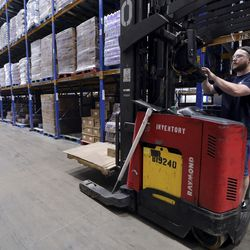 Zach Costigan, Associated Foods senior inventory control specialist, works at the Associated Foods distribution warehouse in Farr West, Weber County, on Wednesday, Aug. 19, 2020.