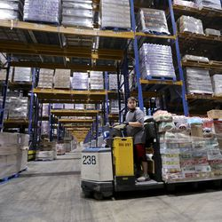 Malique Osorno, Associated Foods distribution specialist, works at the Associated Foods distribution warehouse in Farr West, Weber County, on Wednesday, Aug. 19, 2020.