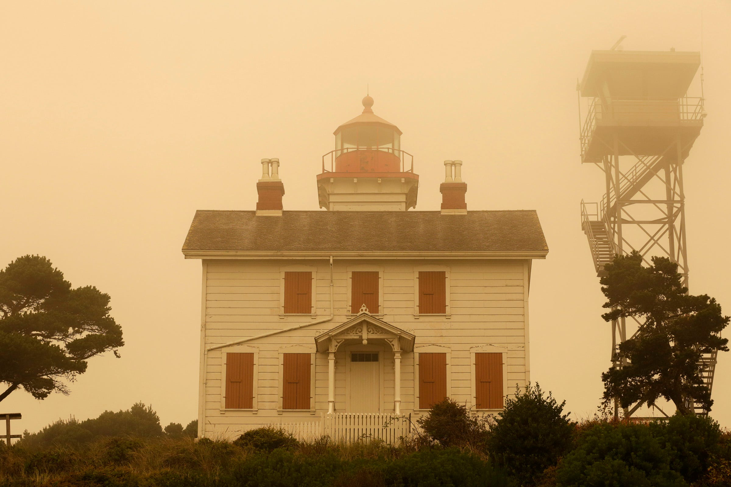 The Yaquina Bay Lighthouse is surrounded by smoke in Newport, Oregon, on Thursday, Sept. 10, 2020.