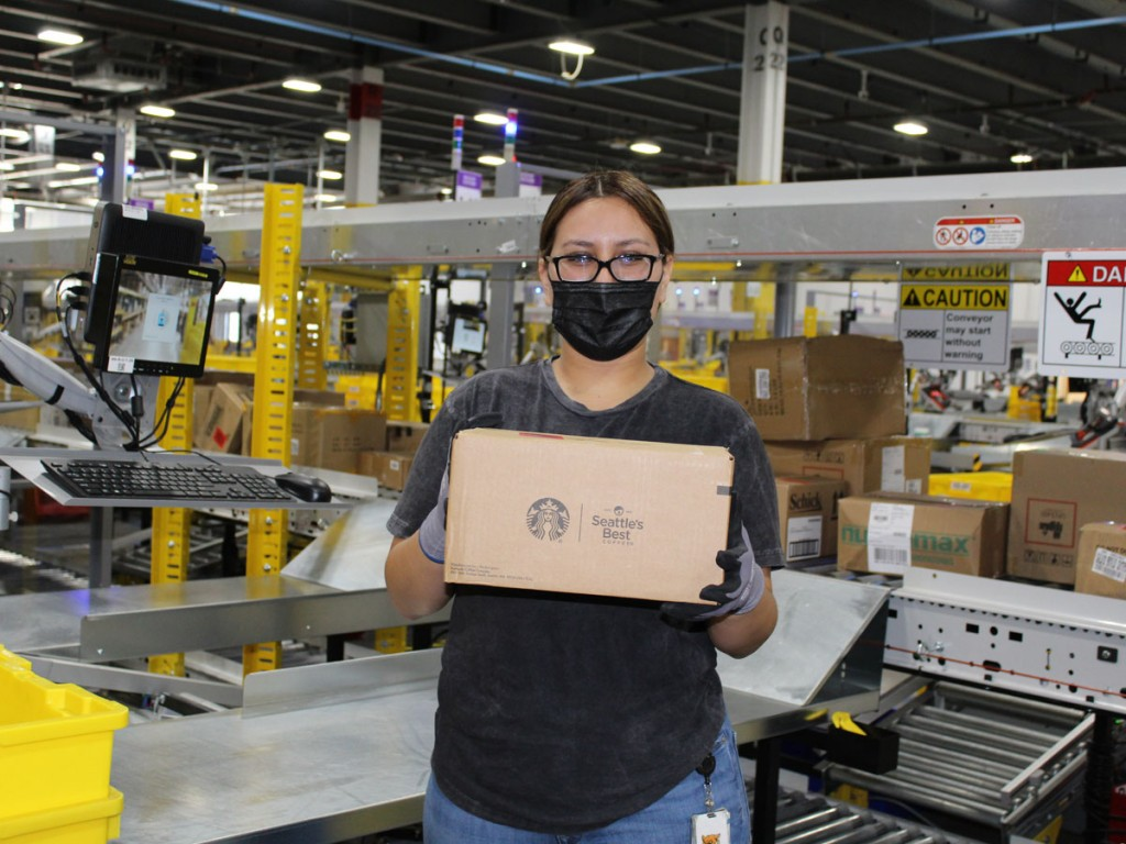 After a morning of safety training and celebration, associates received the first item into the new building: a box of Keurig K-Cup pods. (Photo: Business Wire)