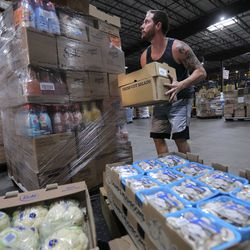 Jesse Stocks, Associated Foods senior distribution specialist/loader, moves produce at the Associated Foods distribution warehouse in Farr West, Weber County, on Wednesday, Aug. 19, 2020.