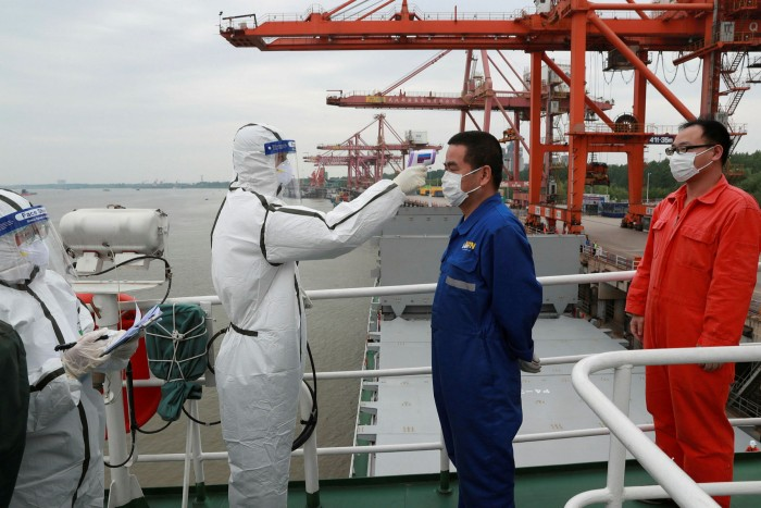 Crew members on a container ship in Wuhan are tested for Covid-19. Despite initial fears over the impact of the disease, the freight rates carriers charge  largely held up