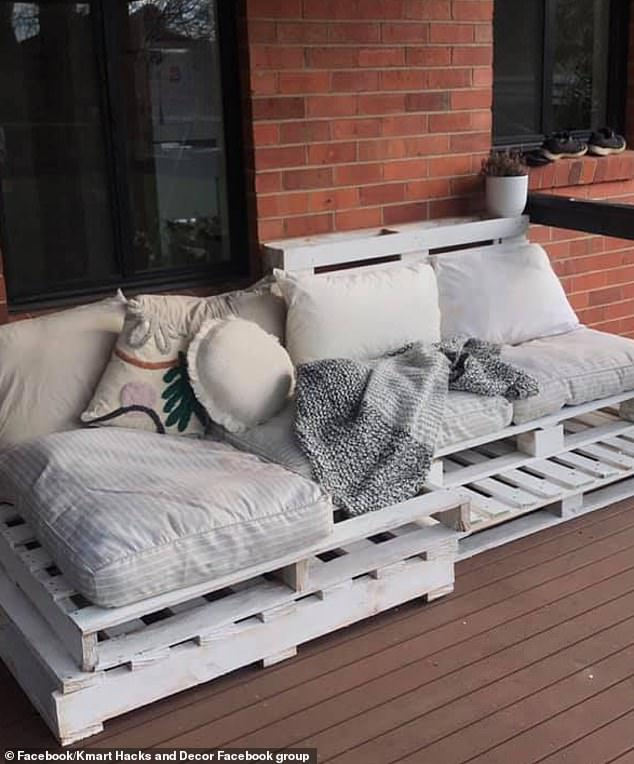 Rather than spending hundreds of dollars on an outdoor furniture set, a savvy DIY couple have built a stylish day bed for only $78 using pallets, three Kmart dog beds and cushions (pictured)