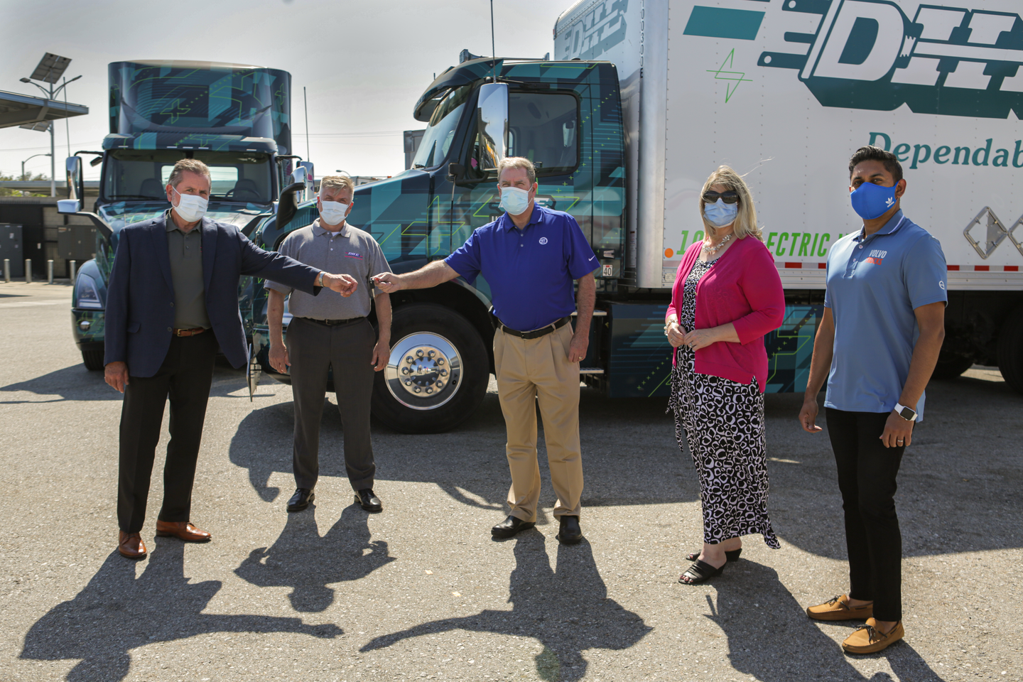 General manager of Volvo Trucks North America's TEC Equipment dealership, Mike Reardon, hands over the keys to the first Volvo VNR Electric Class 8 truck models to Joe Finney with Dependable Highway Express. From left to right: Joe Finney, COO at Dependable Highway Express; Troy Musgrave, director of process improvement at Dependable Highway Express; Mike Reardon, general manager at TEC Equipment; Janice Rutherford, county supervisor of San Bernardino County and South Coast Air Quality Management District board member; Aravind Kailas, advanced technology policy director at Volvo Group North America.