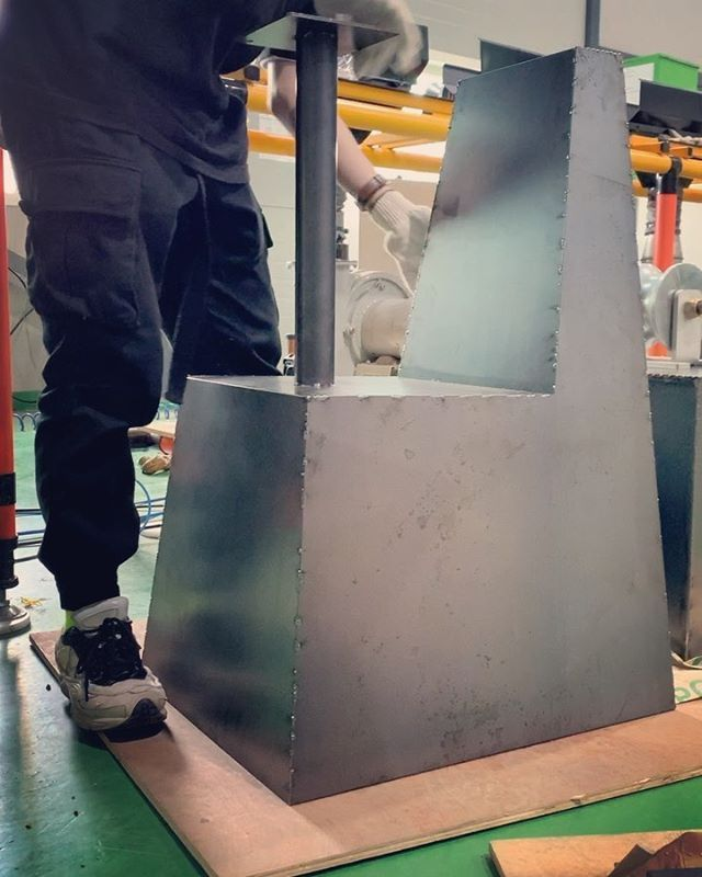 To crush the plastic into the appropriate shape, Kang uses a chair mold.