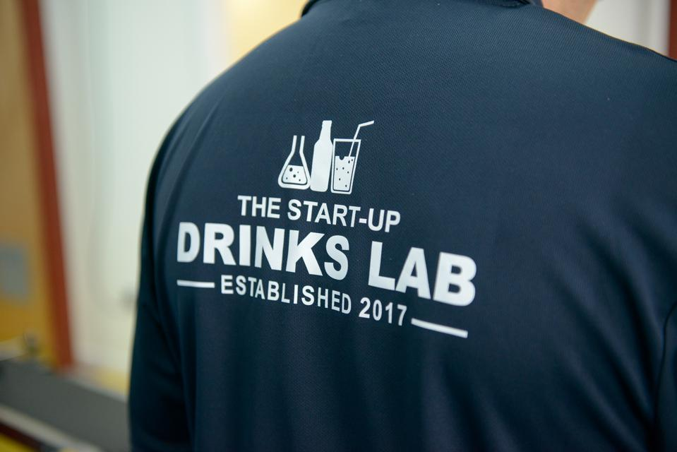 An employee of The Start-Up Drinks Lab works on the production line.