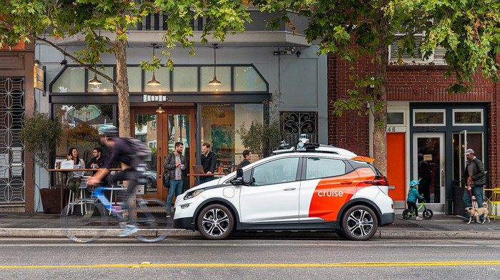 A GM Cruise self-driving taxi prototype on a San Francisco street.