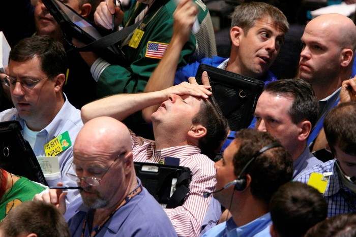 Traders react to the falling market at the New York Mercantile Exchange in 2008