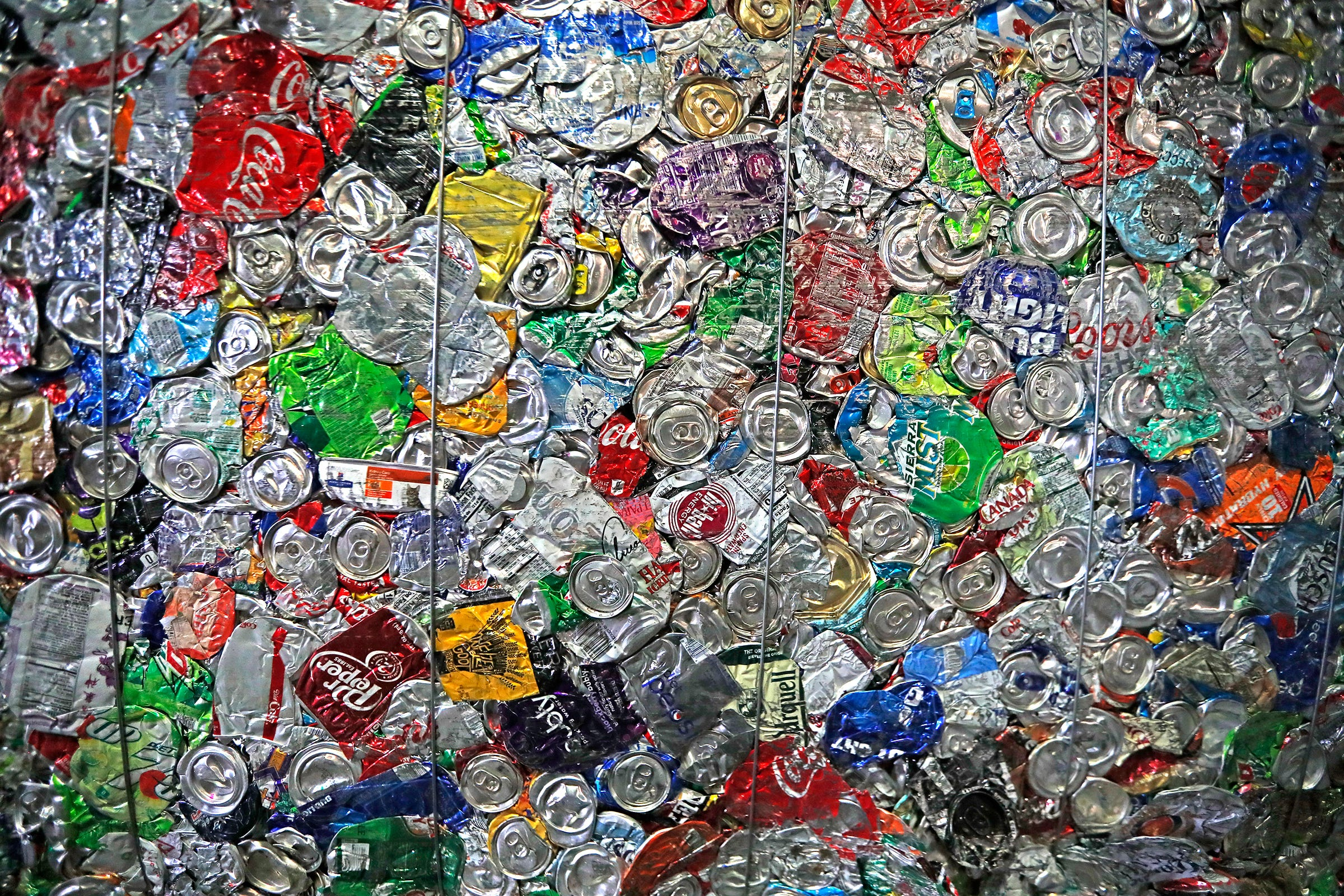 Flattened cans are bound together at the end of the recycling process at the Ray's Indianapolis Recycling Facility, part of Ray's Trash Service, Thursday, Sept. 3, 2020.