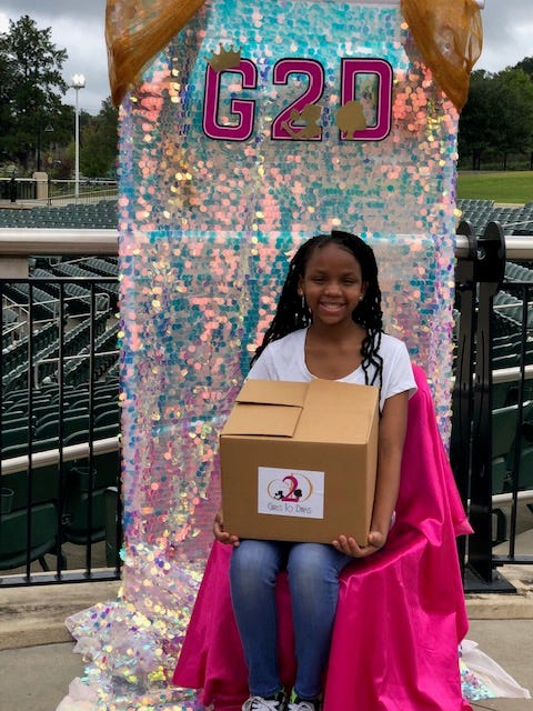 Girls 2 DIVAS members pick up their DIVA boxes for virtual meetings due to COVID-19.