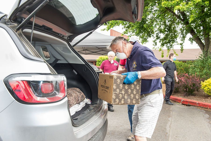 File photo of food giveaway at St. James Catholic Church in McMinnville.