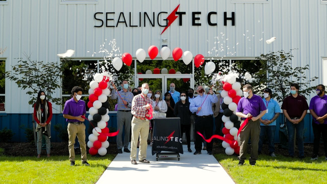Chief Executive Officer of Sealing Technologies Inc, Ed Sealing (center), Chief Operating Officer, Brandon Whalen (right), and Chief Financial Officer, Daniel Zick (left), officiate the Ribbon Cutting Ceremony at the SealingTech Integration Facility in Stevensville, MD.