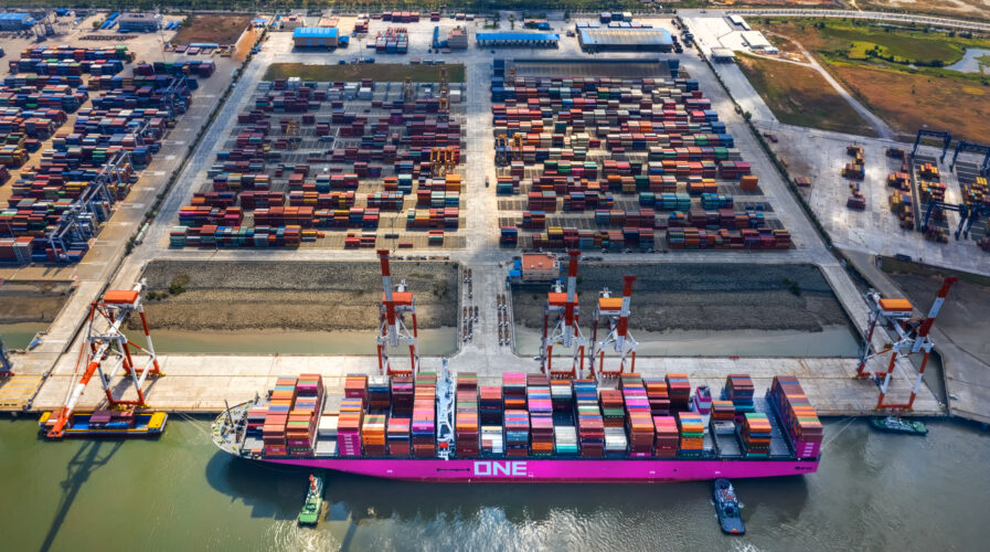 Top view aerial of International container port Tan Cang - Cai Mep. Ba Ria, Vung Tau, Vietnam. Connect to Ho Chi Minh City by Thi Vai river and national road 51