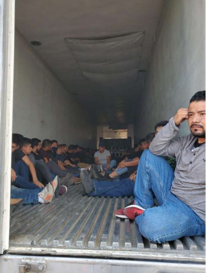 Laredo police officers said they discovered these 63 immigrants inside a trailer. The 18-wheeler was discovered behind Burlington Coat Factory on San Bernardo Avenue. Photo: Courtesy Photo /Laredo Police Department