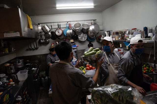 Busy kitchen receiving deliveries (Photo by Toya Sarno Jordan/Getty Images)