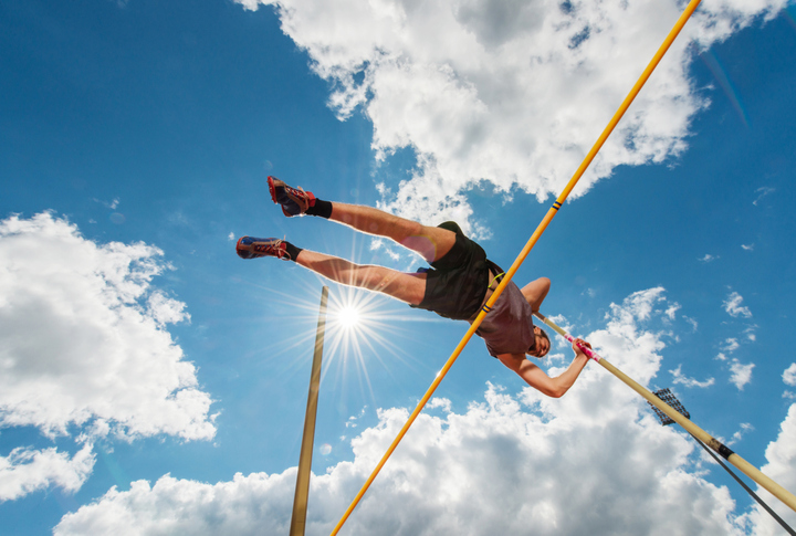 Man completing the high jump
