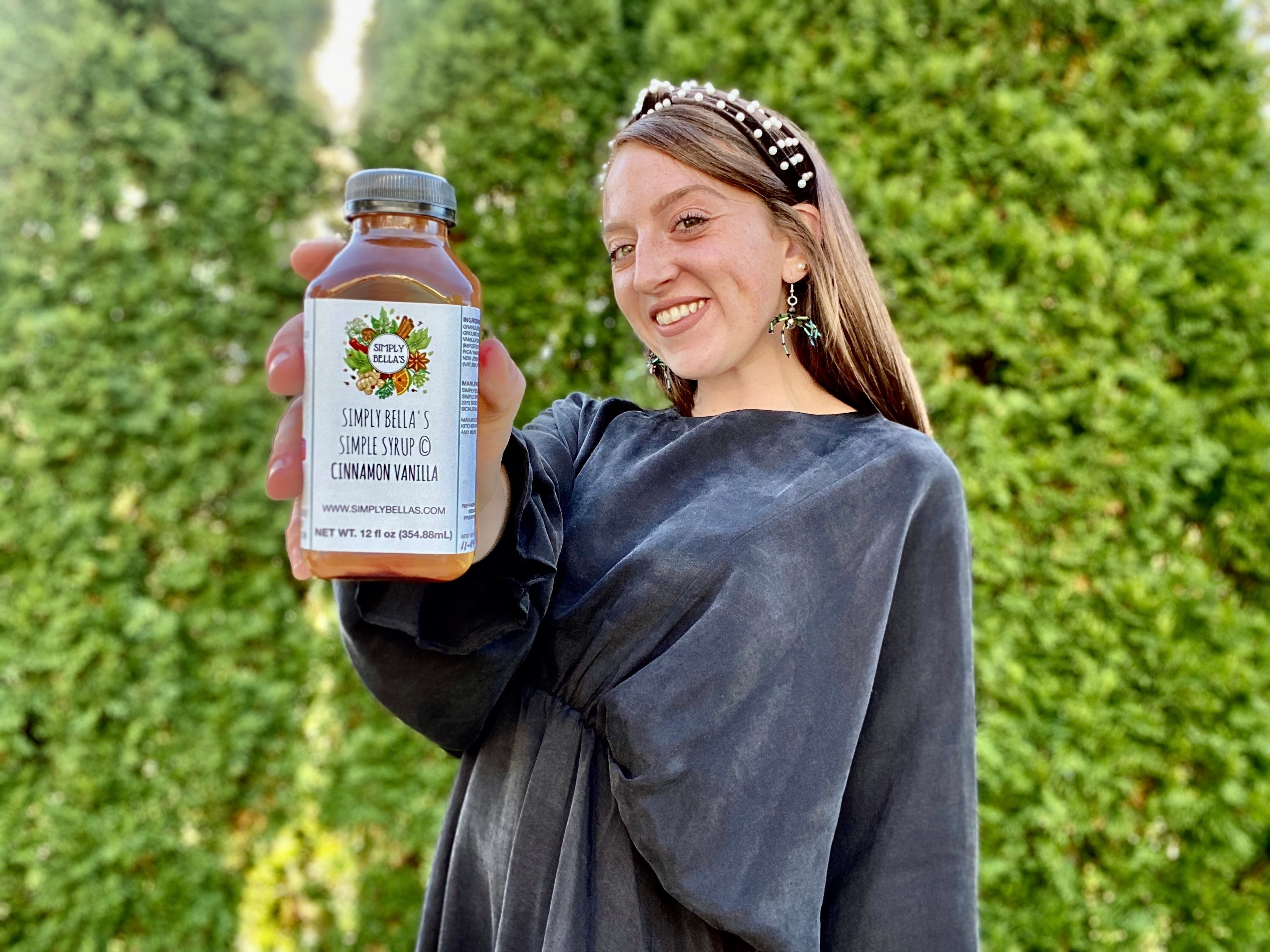 Isabella Abbate, owner of Simply Bella's Simple Syrup, is shown with her cinnamon vanilla flavored simple syrup. Simply Bella's will host its inaugural Harvest Benefit on Oct. 21 at Villari's Lakeside Restaurant & Bar in Sicklerville.