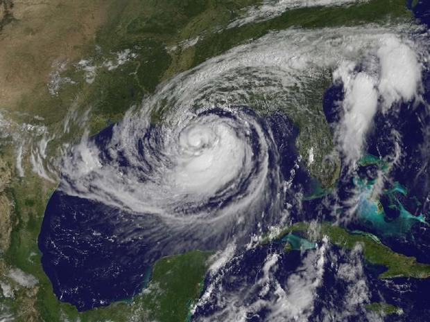This visible image of Tropical Storm Isaac taken from NOAA s GOES-13 satellite shows the huge extent...