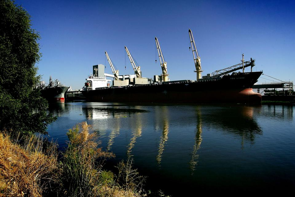 Stockton, California: a container ship is docked in the deep canal of an inland port in the Sacramento-San Joaquin River Delta.
