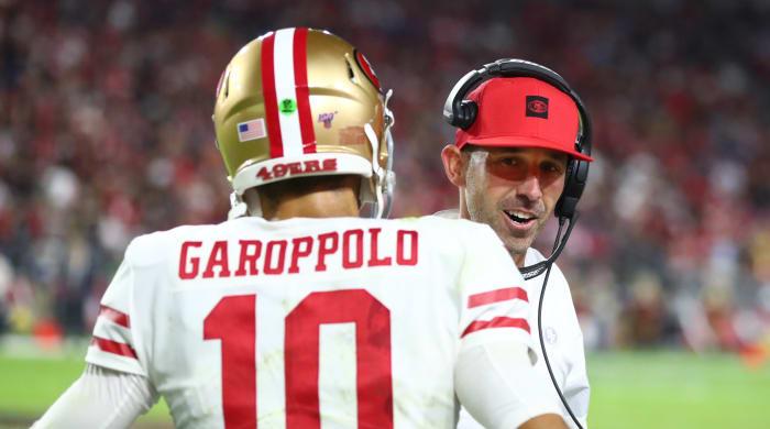 San Francisco 49ers quarterback Jimmy Garoppolo (10) with head coach Kyle Shanahan against the Arizona Cardinals at State Farm Stadium.