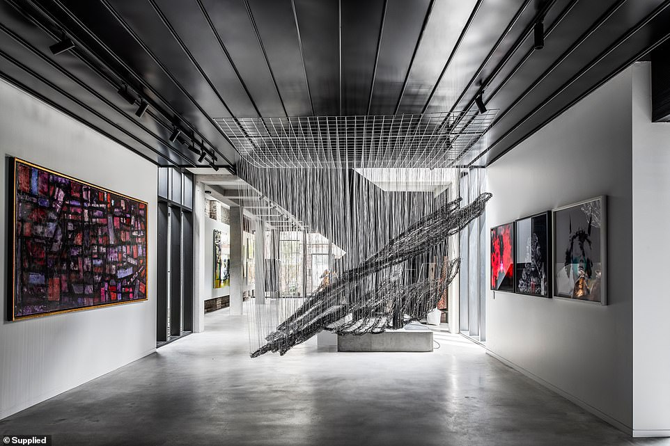 Living in art: The gallery covers most of the ground floor which also houses a study, laundry and home gym