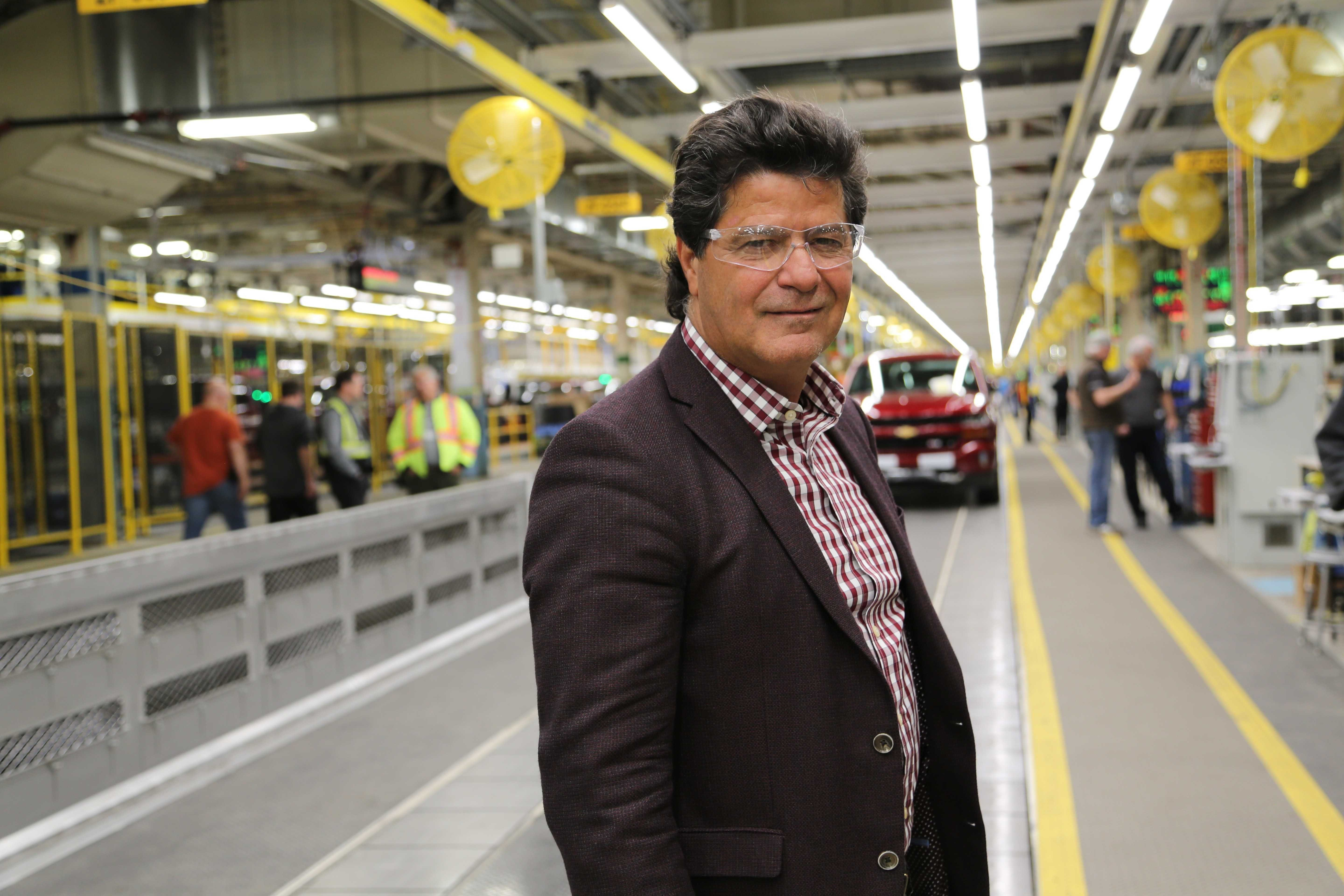 Unifor National President Jerry Dias stands along the assembly line at General Motors' Oshawa Assembly Plant on Feb. 16, 2018. GM has agreed to restart production of Chevrolet Silverado and GMC Sierra light-duty and heavy-duty pickups at the plant in 2022.