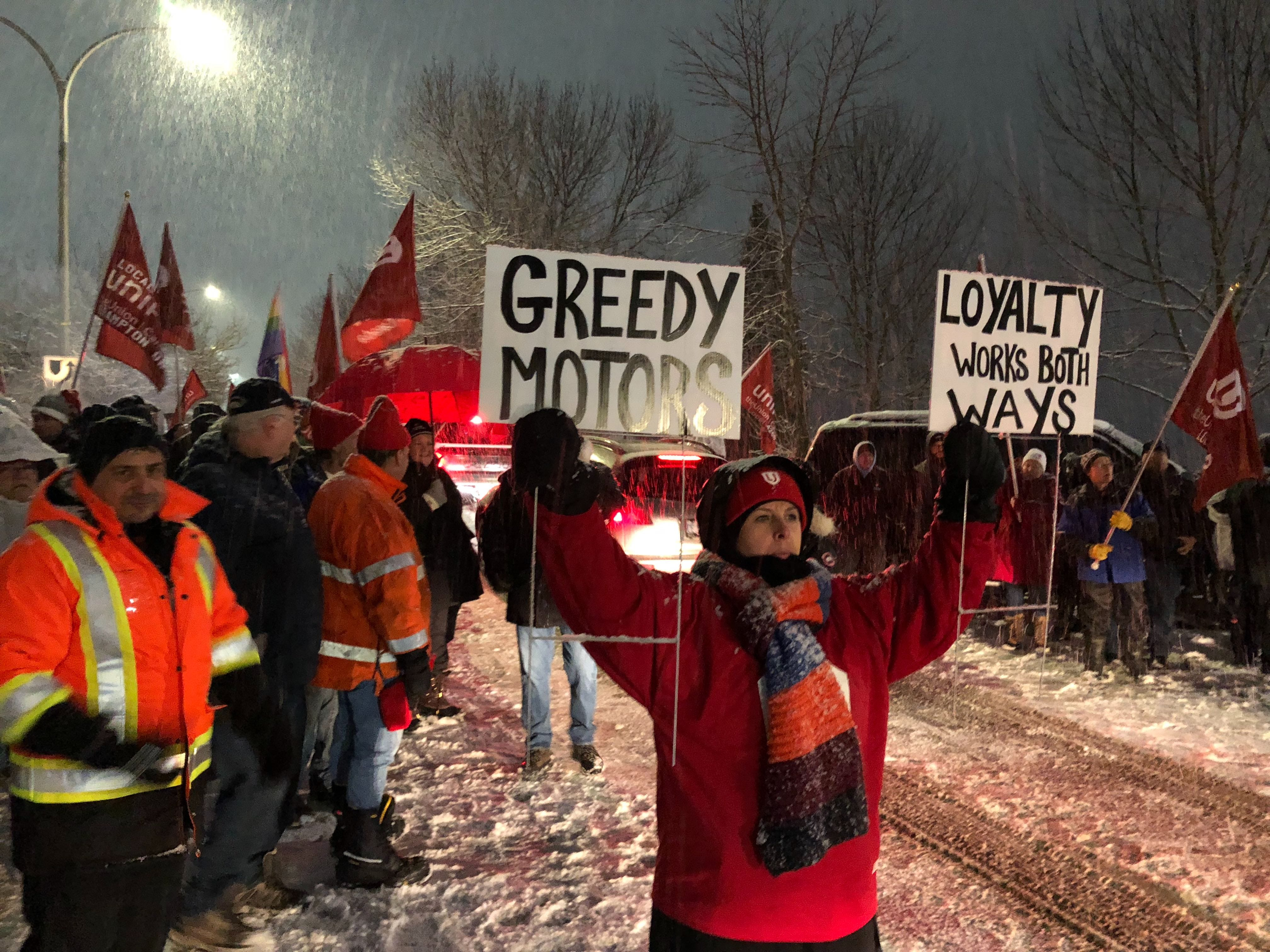 Unifor members protest in front of General Motors headquarters in Ontario, Canada, in 2019 over GM's decision to idle its Oshawa Assembly plant this year.