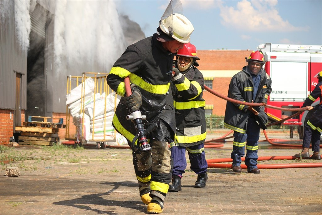 Firefighters battle the factory fire.