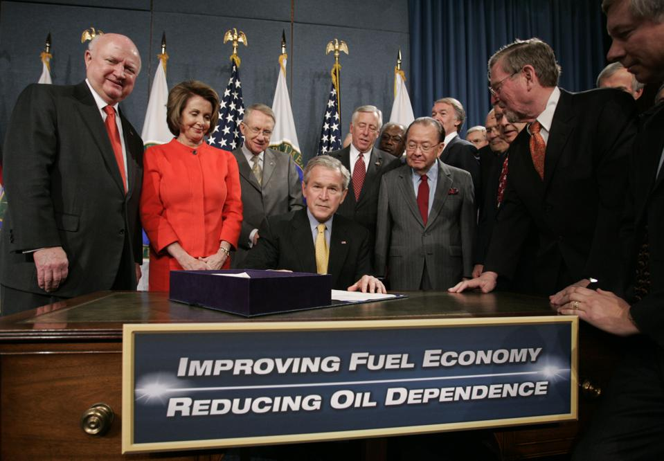 19 Dec 2007: U.S. President George W. Bush (C) with Speaker of the House Nancy Pelosi (2L) sign the Energy Independence and Security Act of 2007. It was the first congressional increase in vehicle fuel-economy standards in 32 years.