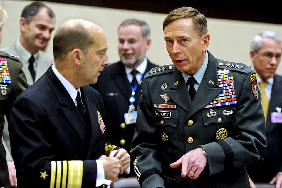 2011: Admiral James Stavridis (L), commander of European Command and NATO's supreme allied commander for Europe, speaks with U.S. Army Gen. David H. Petraeus, right, commander of NATO and U.S. forces in Afghanistan.