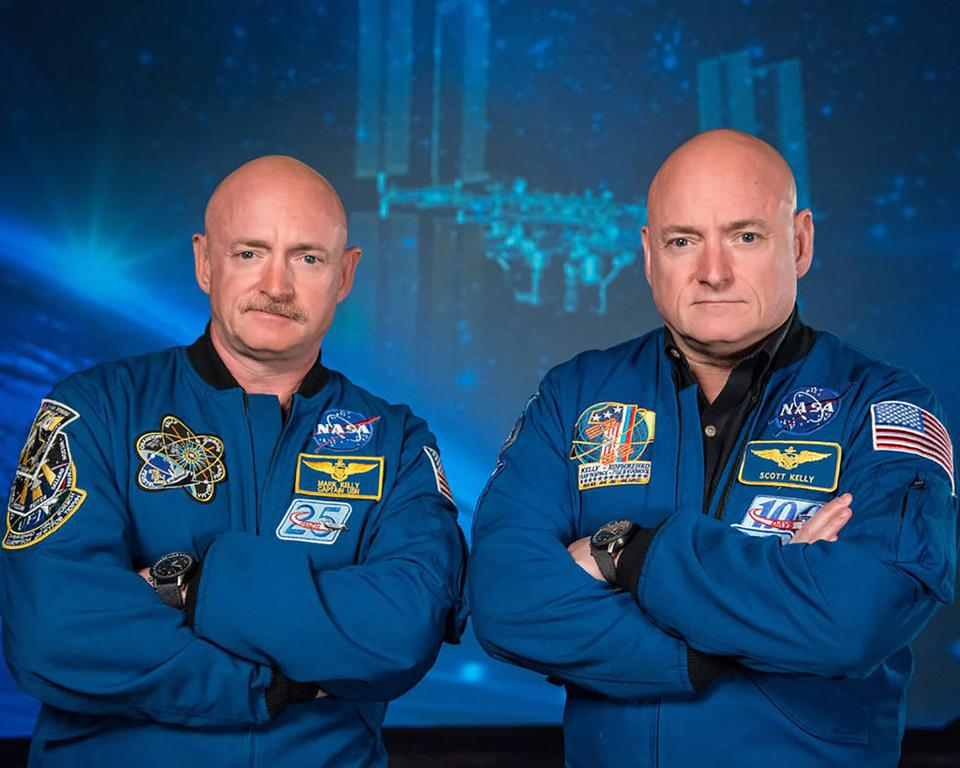 Astronaut Scott Kelly (R), who was the Expedition 45/46 commander during his one-year mission aboard the International Space Station, along with his twin brother, astronaut Mark Kelly (L).