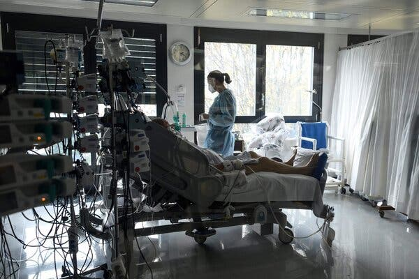 A medical worker monitors a patient in a hospital intensive care unit for Covid-19 patients in La-Chaux-de-Fonds, Switzerland.
