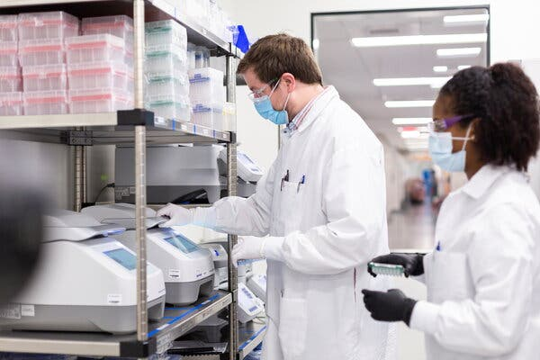 Researchers working in a Moderna lab. The drugmaker estimates that its coronavirus vaccine is 94.5 percent effective.