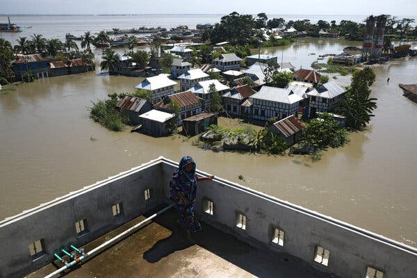 Houses located beside the Padma river are seen flooded in Munshiganj district, on the outskirts of Dhaka, Bangladesh, in July.