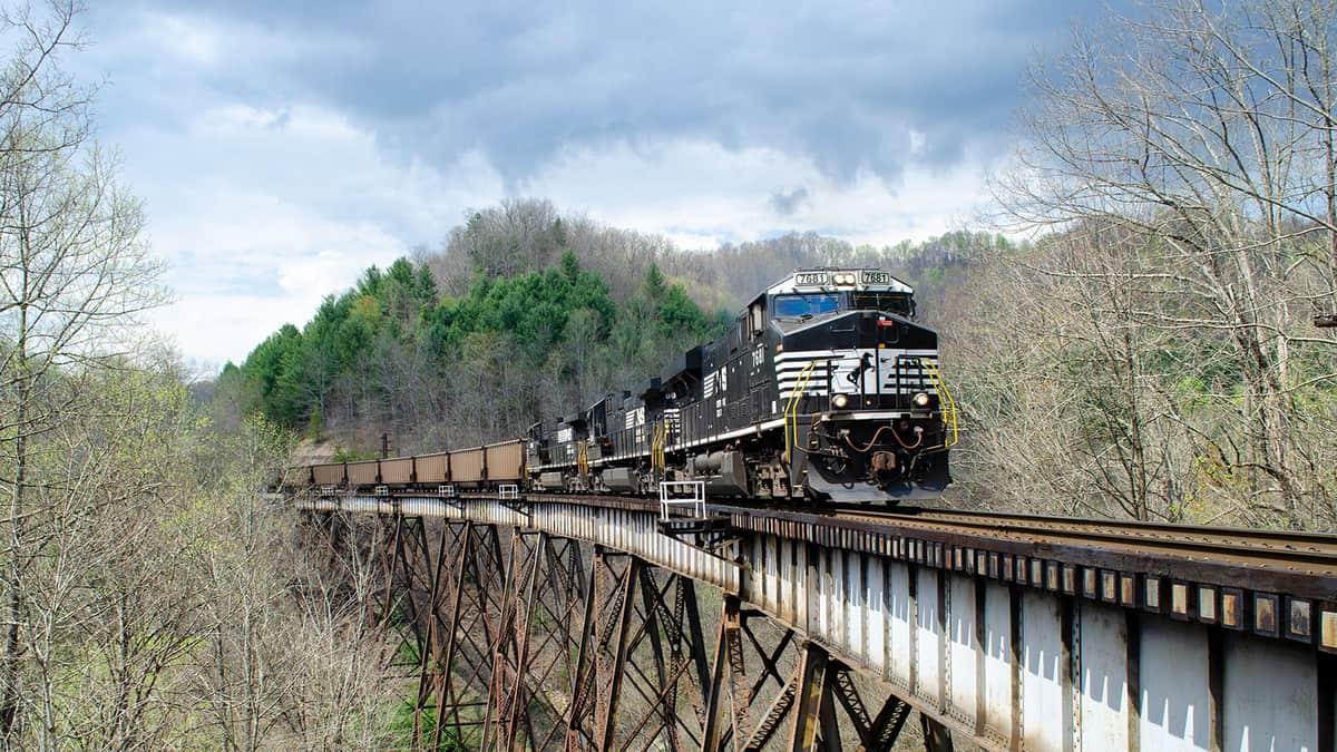 A photograph of a train crossing a bridge.