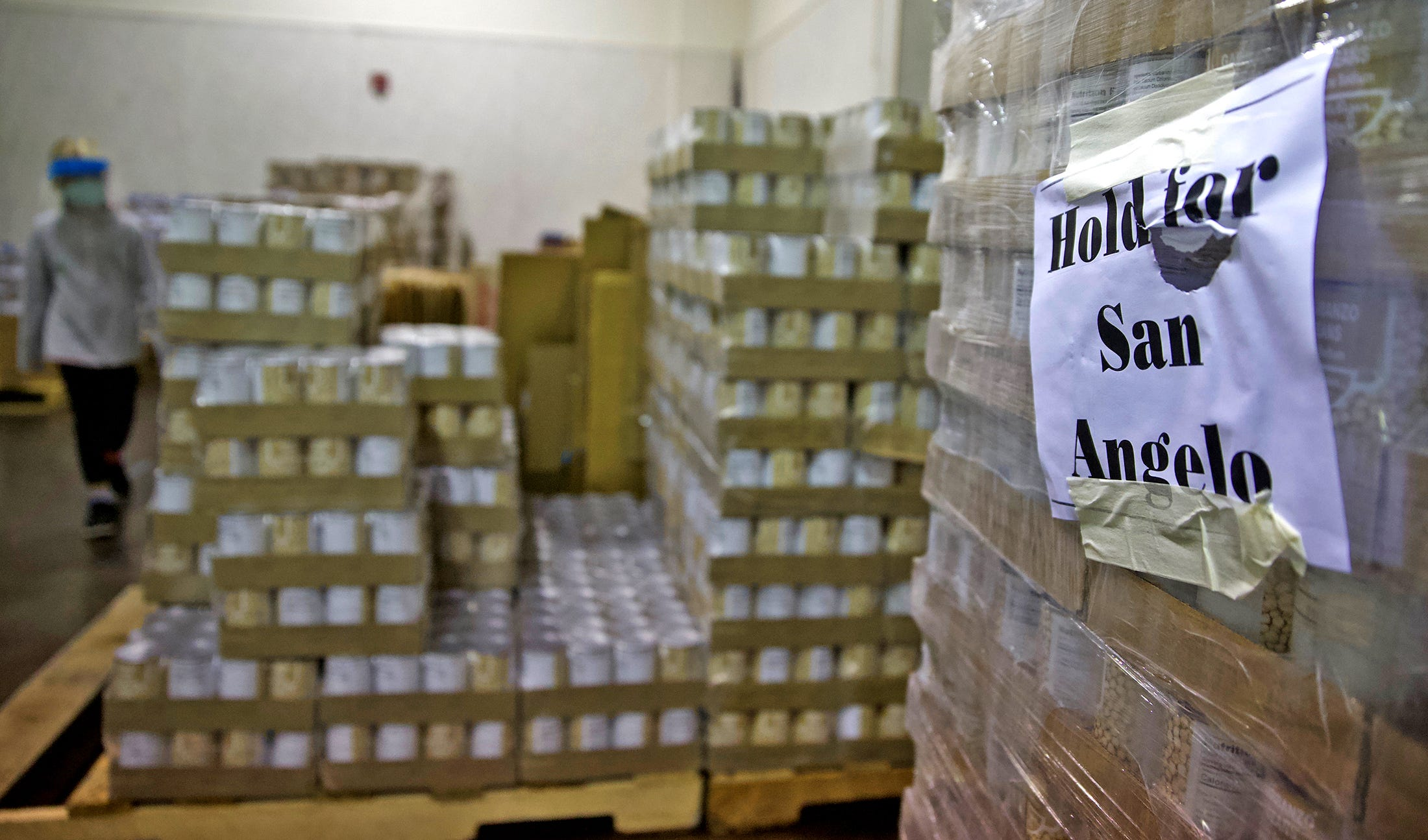 Canned goods sit stacked on pallets during a food distribution event at the St. Paul Presbyterian Church on Saturday, Nov. 21, 2020.