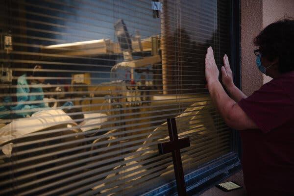 Melissa Montoya prayed outside the hospital room of her lifelong friend Sylvia Garcia in Las Cruces, New Mexico, last week.